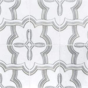 A white natural stone decorative element 2pc. petal imprint tile by Jeffrey Court.