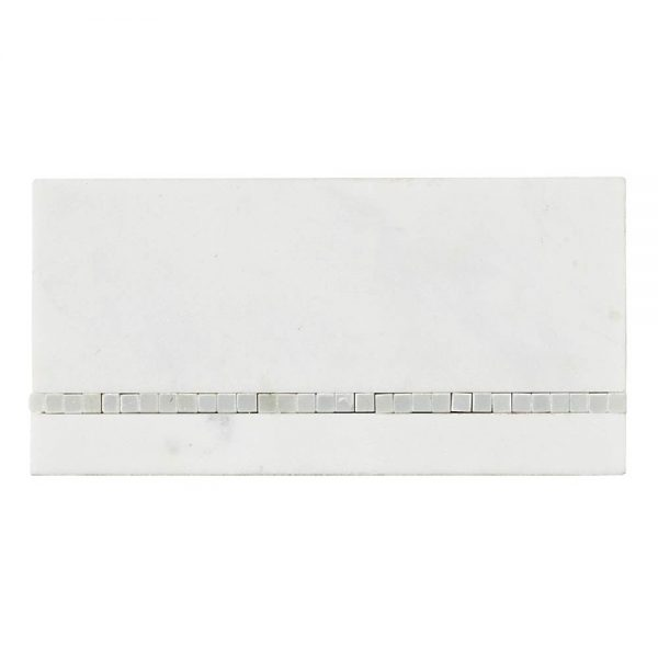 A white natural stone border/listello broadway border tile by Jeffrey Court.