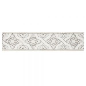 A white natural stone decorative element cathedral border tile by Jeffrey Court.