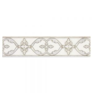 A white natural stone decorative element chateau border tile by Jeffrey Court.