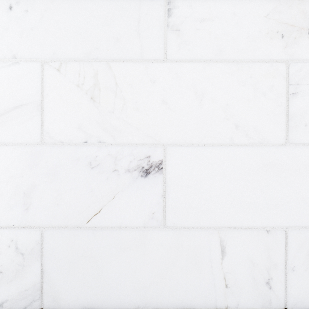A white natural stone field tile by Jeffrey Court.