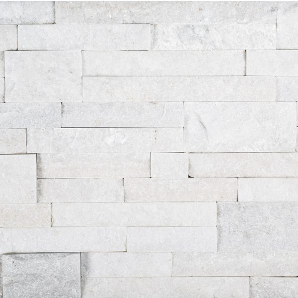 A white natural stone field ledger panel tile by Jeffrey Court.