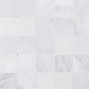 A white natural stone mosaic octagon botticino dot tile by Jeffrey Court.
