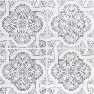 A white natural stone decorative element spanish cathedral tile by Jeffrey Court.
