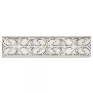 A white natural stone decorative element temple border tile by Jeffrey Court.