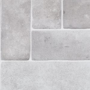 A white porcelain field cabrillo brick tile by Jeffrey Court.