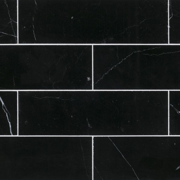 A black natural-stone field tile tile by Jeffrey Court.