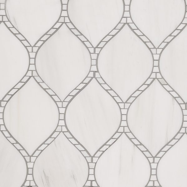 A white natural-stone mosaic baton rouge tile by Jeffrey Court.