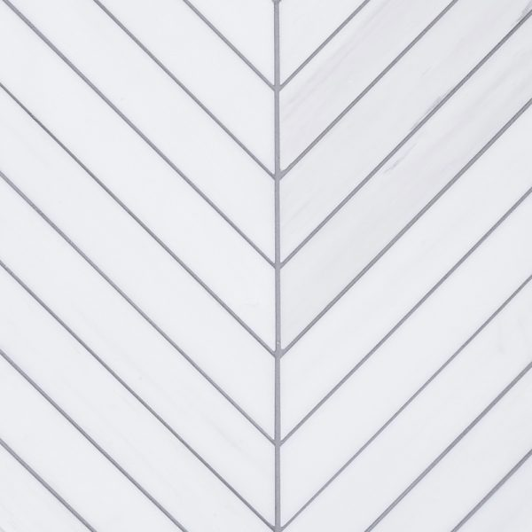 A white natural stone mosaic chevron tile by Jeffrey Court.