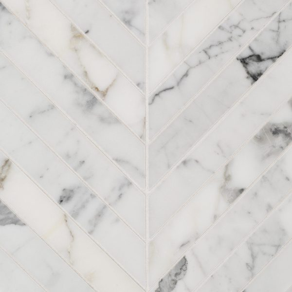 A white natural-stone mosaic chevron tile by Jeffrey Court.