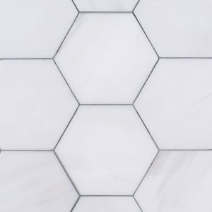 A white natural-stone field tile tile by Jeffrey Court.