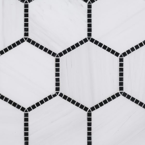 A white natural-stone mosaic olympia tile by Jeffrey Court.